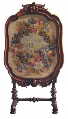 Antique Fire Screen With Mahogany Frame Stands On Four Mahogany Legs And A Floral Embroidery Design  -  English   c.1860