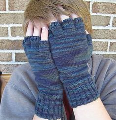 Simple stockinette gloves with half fingers to fit a man's small hand, or a woman's large. Full fingers can easily be substituted. Thumb is placed slightly toward the palm, and pinkie finger is lower than the other three fingers.