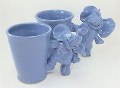dancing elephant mugs by Gary Rith