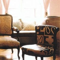 Upholstery using traditional, formal French furniture in Kuba cloth or geometric patterned cotton and raffia from Senegal.