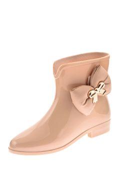 Pretty rain boot with a bow.