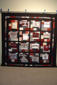 T-shirt quilt. This one someone else made, but it uses a lot of accent fabrics around larger pieces of the t-shirts to give it a more patchwork feel. This is a great way to stretch the size of a quilt if you don't have a lot of shirts to work with
