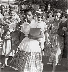 It was the fourth school year since segregation had been outlawed by the Supreme Court. Things were not going well, and some southerners accused the national press of distorting matters. This picture, however, gave irrefutable testimony, as Elizabeth Eckford strides through a gantlet of white students, including Hazel Bryant (mouth open the widest), on her way to Little Rock's Central High.
