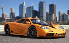 McLaren F1 can reach speeds of up to 240 mph, equipped with a 6 liter v12 engine for maximum speeds.
