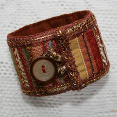 Make cool cuffs out of bits of scrap fabric and a button. Use a stiff shirt cuff as a base and build on densely. Fiber Art Jewelry, Textile Jewelry, Fabric Jewelry, Jewelry Art, Jewelry Design, Bracelet Crafts, Jewelry Crafts, Handmade Jewelry, Fabric Bracelets