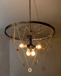 Unique chandelier hand-crafted using recycled and restored bike parts, Victorian style Edison bulbs, elegant hanging chains, and washers. An eighteen foot wire makes it possible to hang and plug in almost anywhere.