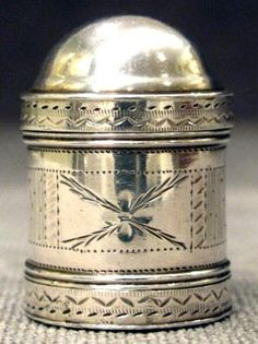"A Fine George III Sterling Silver Nutmeg Grater, Hallmarked Birmingham 1791  The bullet-shaped body engraved with bright cut detail, the domed top lifting to receive a nutmeg nut, the base having an iron grate covered with a removable flattened cap. Makers marks for Samuel Pemberton. Height -1.25"", Weight -11grams"