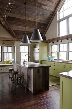 Home Tour: Lakefront Living. The green cabinets are a little sterile, but I love the openness and reclaimed lumber. Green Kitchen, New Kitchen, Kitchen Decor, Kitchen Rustic, Industrial Farmhouse, Country Kitchen, Kitchen Interior, Rustic Kitchens, Coastal Interior