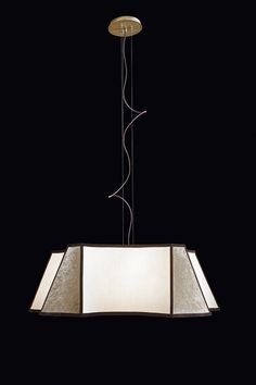 """The lines of nature reinvented with a touch of Art Déco – are the main inspiration for this simple and elegant hanging lamp: Pentagono lighting collection by Oasis, designed to fit gracefully into the most sophisticated interiors. Through its sand cotton lampshade, finished in rich, luxurious velvet, with a velvet grosgrain border for décor, """"Pentagono"""" sheds a soft, comfortable light which imparts an immediate relaxing effect to the ambient it inhabits."""