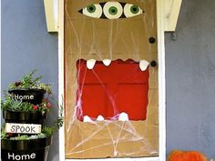 How To Make A Halloween Paper Bag Door Monster | HomeJelly - maybe use colored plastic tablecloth instead of brown bags? Wouldn't it be great to make the mouth around a doggy door? Every now and then a dog pops out.