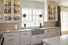Stainless farmhouse sink with towel bar  Blanco Magnum Caesarstone Quartz in London Grey Ballard Topiary Waterstone Annapolis faucet LB Brass pewter hardware French Casement Window Spode Blue Italian Dishes