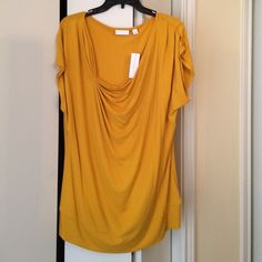 New and York company gold asymmetrical stretch too XL pretty gold stretch new work and company stretch gold asymmetrical top with pleating on the sleeves.. Great to wear to work or on the weekends.. New with tags New York & Company Tops Blouses