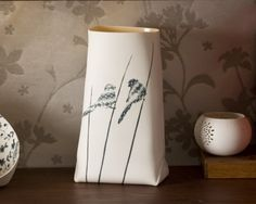 handcrafted folded porcelain vase by Ady Shapira. Hand built from paper thin porcelain slabs, decorated with black birds inlay.
