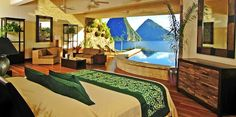 outdoor patio infinity pool (i'd say somewhere in St Lucia in Caribbean by the looks of it! exotic hotel warm country big bed, nice interior, wooden furniture, blue mountains, nature view
