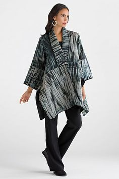 Quilted Travel Coat by Amy Nguyen.This coat is a show-stopping work of art hand-dyed using traditional Japanese shibori techniques--a masterpiece of intricate surface design and architectural shape. The artist carefully folds, binds, and stitches the fabric before dyeing it to create richly detailed patterns.