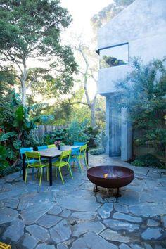 A paved dining area in Fiona Brockhoff's Toorak garden.