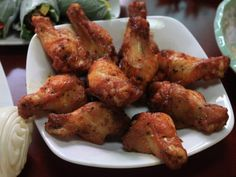 A recipe for Bahama Breeze's Jamaican Jerk Grilled Chicken Wings made with garlic, thyme, allspice, water, scallions, chicken wings, jerk seasoning, olive oil