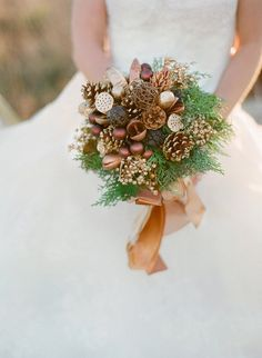 Ditch the flowers for Winter foliage like pinecones and other woodsy elements. It's an affordable option that creates a stunning bouquet.  Photo by Anne Robert via Style Me Pretty                                                                                                3 / 14