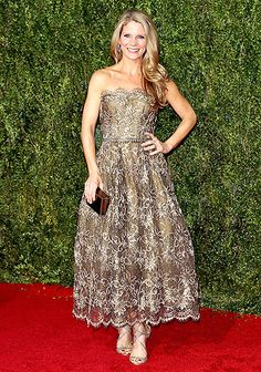 King & I actress Kelli O'Hara looked lovely in a bronze lace, tea-length dress with scalloped edges, plus a square clutch and metallic sandals.