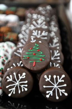 EASY Christmas cookies. Cover oreo cookies in melted chocolate and decorate!