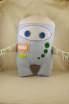 Ezra wants a stuffed robot made out of alien fabric.  It ain't gonna be pretty, but I gotta make it.