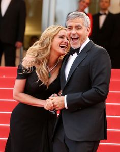 Julia Roberts and George Clooney at the premiere of Money Monster in Cannes. May 2016