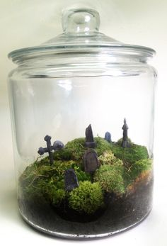 This is awesome!!!! Large Creepy Halloween Graveyard Terrarium. $70.00, via Etsy.