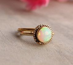 If you're looking for a ring that embodies vintage jewelry, we suggest this simple braided opal ring by Studio1980.