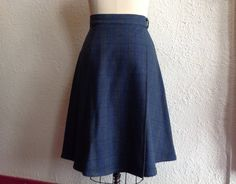 This cozy skirt is made out of plaid, cotton flannel in blue, green and black. It is an ajustable, wrap style that ties at the front waist and has two patch pockets on the front. Size 10-14 Fits a 30-34 waist (adjustable) 41 total length of waistband 27 long  Machine washable