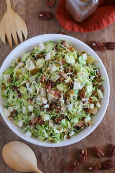 Brussels Sprout Chopped Salad with bacon, candied pecans, pears, blue cheese, and maple-bacon vinaigrette