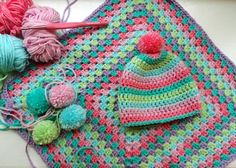 Crocheted hat and granny square baby blanket