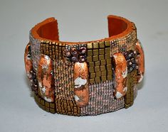 BEAD EMBROIDERY BRONZE CUFF - Bronze, pink and gray tones. Hand made by Charles Tabay.
