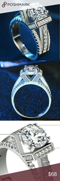 RING ⚘ SZ 6,7,8 & 9 Man-Made diamonds and CZs Truly beautiful ring.  Spectacular, reflective an extremely elegant Center stone is a Man-Made Diamond Solitaire  The height on this ring is extremely sophisticated the ring itself is very tight and Incredibly well made. Jewelry Rings