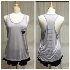 Gray Tank-Beauty Begins the Moment You.. Gray Heart Graphic Tank-Racerback. A bit sheer. On the back says 'Beauty Begins The Moment You Decide To Be Yourself'. Absolutely love this quote! 50% Polyester 50% Rayon. True to size. S-L-23 underarm to underarm (u2u)16 1/2, Bottom width 19 in  M-L-241/2, u2u-17 1/2, Bottom W 20 1/2in L-L-25 1/2, u2u-18 1/2, Bottom W 21 1/2in April Spirit Tops Tank Tops