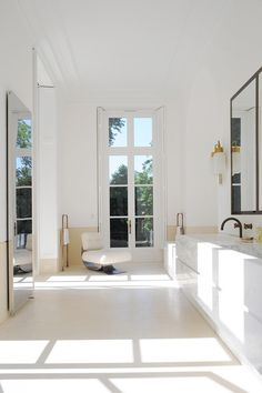 In the marble bathroom, one can rest close to the immense windows in a chair by Oscar Niemeyer. The LP 10 fixture is by Luigi Caccia Dominioni (Azucena). http://www.yatzer.com/joseph-dirand-saint-germain-paris // Photo © Adrien Dirand / AD France n° 119, September/October 2013.