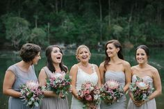 Bride and her bridesmaids in dove-grey dresses with Australian Native bridal bouquets | PHOTO CREDIT: David Campbell