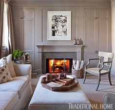 A traditional, gray paneled study with a fireplace is welcoming and cozy. - Traditional Home ® / Photo: Ron Blunt / Design: Mary Douglas Drysdale. Love this neutral room with elements of nature. Living Room With Fireplace, My Living Room, Living Spaces, Cozy Living, Beautiful Interiors, Beautiful Homes, Home Office Decor, Home Decor, Traditional House