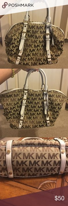 Authentic Michael Kors Bag Sides can be snapped down for a different appearance. Leather trimmed with monogrammed canvas. Large interior with multiple pockets. Side tabs for optional shoulder strap (not included) Michael Kors Bags Satchels