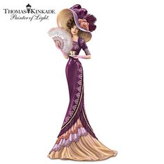 """Thomas Kinkade """"An Elegant Love Figurine."""" Limited-edition, handcrafted Victorian ladies hand-painted in shades inspired by the artist's paintings and accented with detailed real feather fans."""