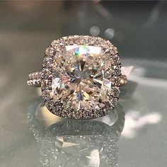 Stunning 7-carat cushion cut with diamond pave halo engagement ring. Available at Alson Jewelers. Call 216-464-6767 for more information. www.alsonjewelers.com. #APBling | Aisle Perfect