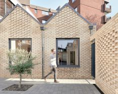 Wheat-coloured bricks have been used to clad the exterior of the homes and have been double-stacked in some areas to form a textured surface. Pula, Exposed Rafters, Brick Architecture, Residential Architecture, Small Buildings, House Roof, Open Plan Living, Wooden Flooring, Building A House