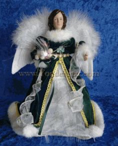 Beautiful Irish angel treetopper dressed in green and white, with fiber optics delivering an illumination around the feathery wings. 12 inches tall