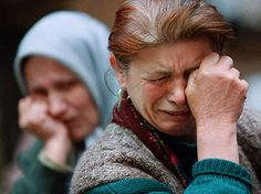 Rabie Ahmeti, 45, a Kosovo refugee who was separated from her son in Macedonia, weeps at a refugee shelter in Albania. Carol Guzy.