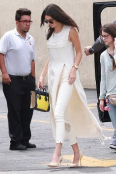 Kendall Jenner wearing Celine Nano Yellow Bag, the Row Wellan Woven Silk Tunic, the Row Stratton Cotton-Blend Leggings and Sophia Webster Coco Pumps