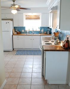 kitchen turquoise backsplash butcher block counters white cabinets white appliances - Kitchen Remodel With White Appliances
