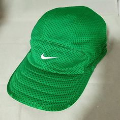 NIKE Dri-Fit Ladies Green Work Out Running Cap Hat Brand: Nike  Item: Dri-Fit Dark Green (darker than pictures) nylon baseball cap with adjustable strap. Color: Green Size: OSFA Condition: Excellent Pre-loved condition  Please check my other listings for bundles to pay one shipping charge as I have a lot of small things listed. 10% off 4+ bundles YOU make. No lowballs. Nike Accessories Hats