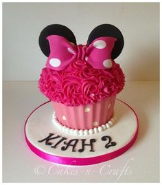 Minnie Mouse giant cupcake with a chocolate pink and white spotty case. The customer requested it to be mostly pink