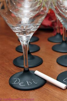 Chalkboard on the wine glasses so guests can write their name, then take it home as a gift favor. Link to tutorial on the page.