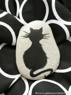 Black cat painted on a rock