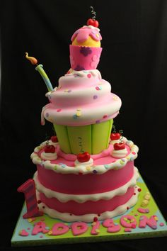 Stacked cake and cupcakes - Cake made for a cupcake themed first birthday.
